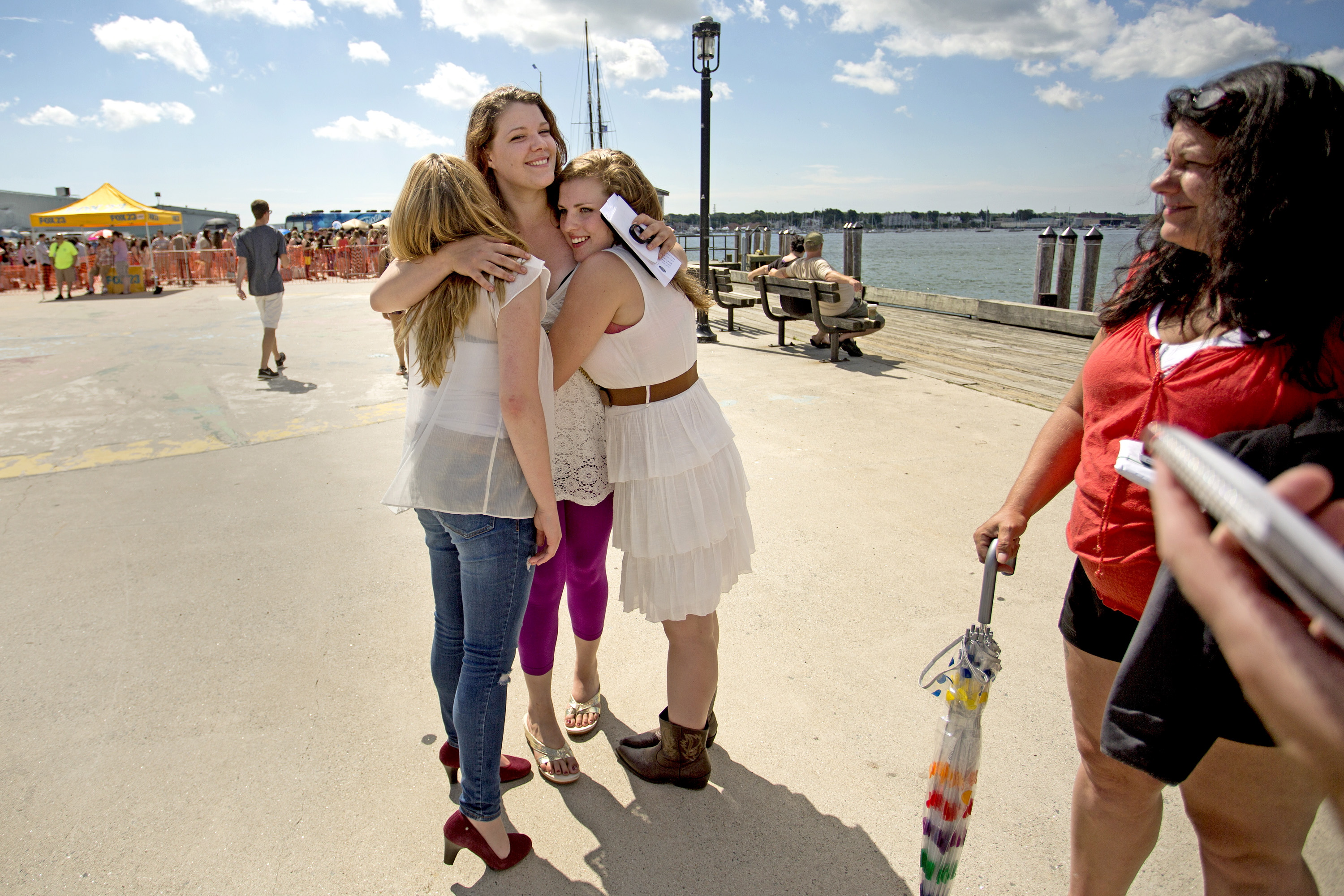 "Abigail Day, 17, of Cornish, left, Jaile Kane, 25, of Ellsworth, and Miranda Mastera, 16, of Hiram, embrace after the trio auditioned but didn't make the cut for ""American Idol"" on the Maine State Pier in Portland on Wednesday."