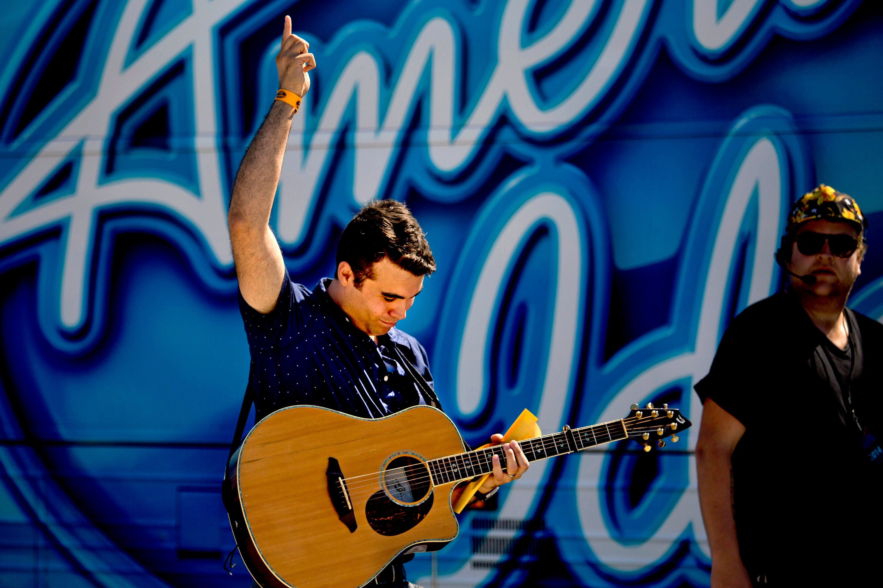 "Tom Emerson, 26, of Wells, celebrates after he made the first cut at auditions at the ""American Idol"" bus on the Maine State Pier in Portland on Wednesday."