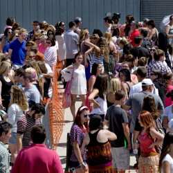 Contestants wait in line on the Maine State Pier in Portland to audition for American Idol on Wednesday.