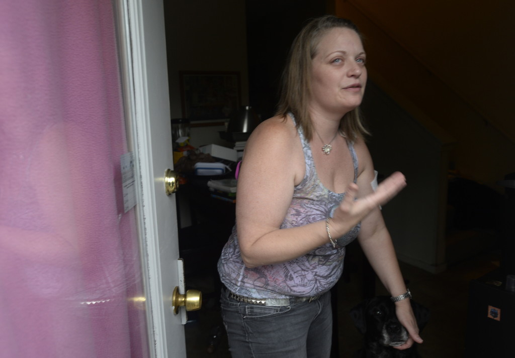 Heather Lemmers talks with a reporter at her apartment at RiverView Apartments in Saco Monday.  Shawn Patrick Ouellette / Staff Photographer