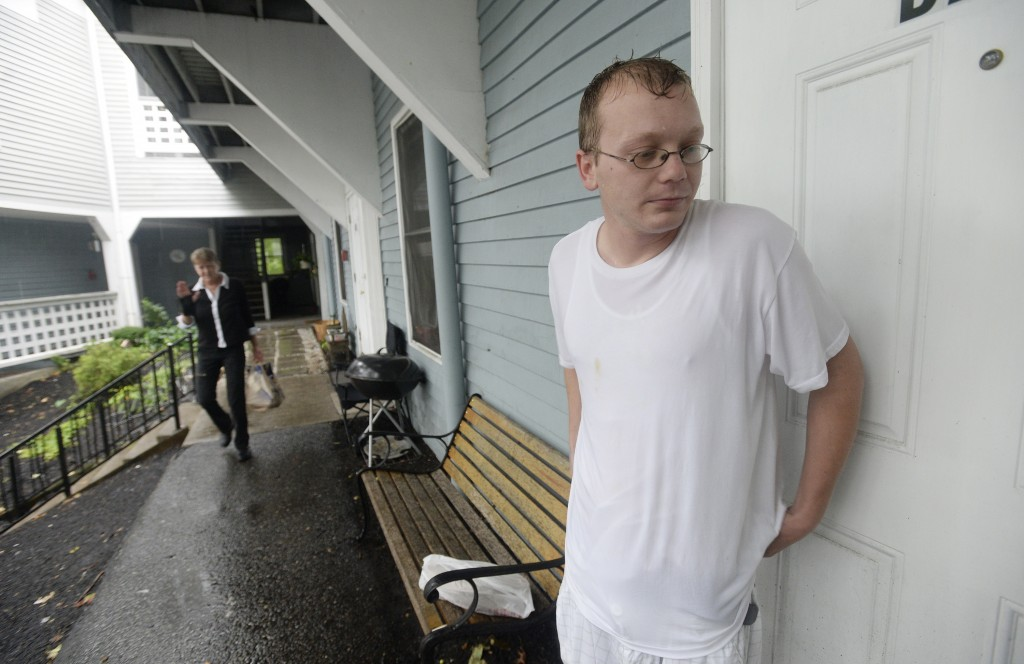 Aaron Petrin talks with reporters outside his apartment at RiverView Apartments in Saco Monday. Shawn Patrick Ouellette/Staff Photographer