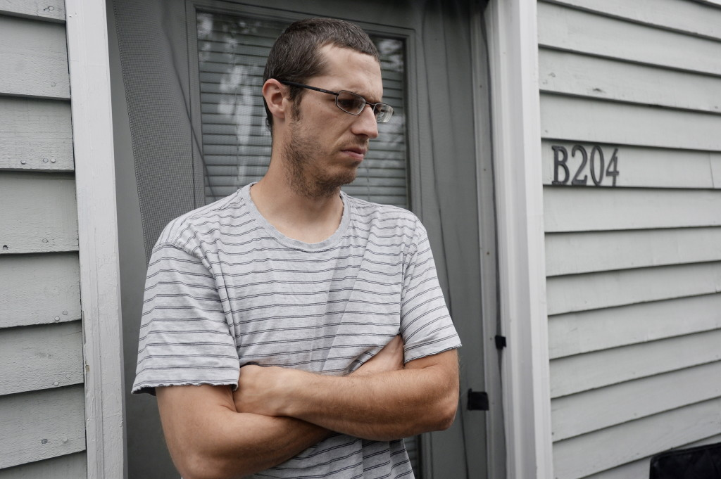 Ryan Lamb talks with reporters outside his apartment at RiverView Apartments in Saco Monday. Shawn Patrick Ouellette/Staff Photographer