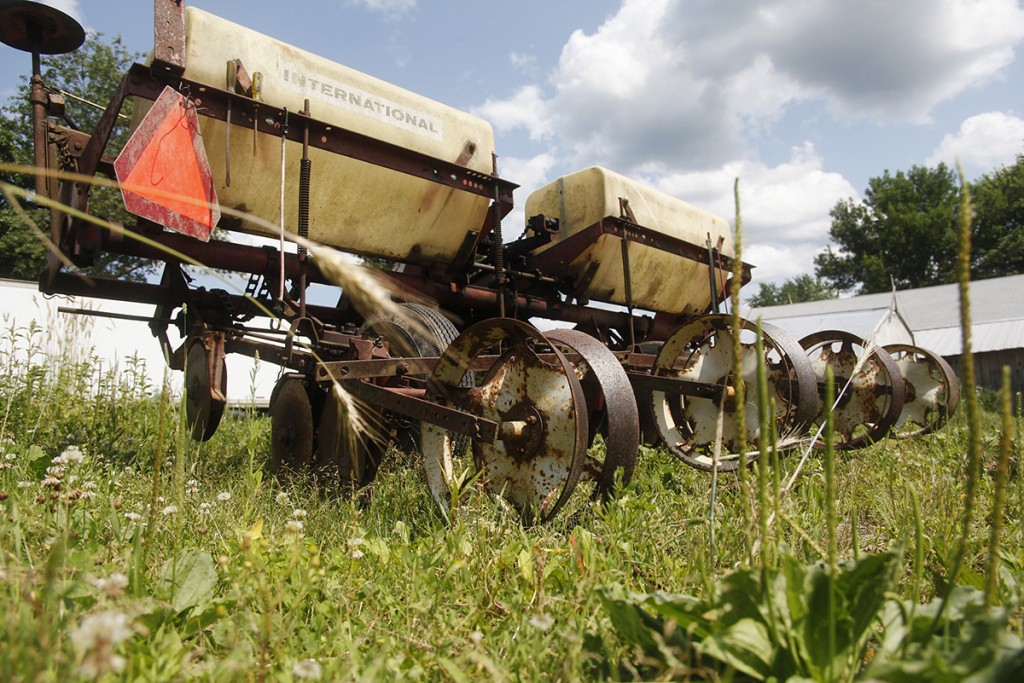 """Baer uses this 1960-era International planter to plant his 20 acres of heirloom beans. The planter can plant four rows at once, adds fertilizer and plants an acre an hour. """"Growing beans takes a lot of specialized machinery,"""" says Baer."""