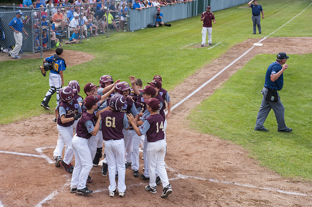 Saco celebrates a Will Mitchell homerun against Falmouth at the Hill Street Field on Thursday, July 24, 2014. (Photo by Logan Werlinger/Staff Photographer)