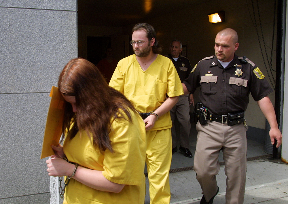 Krissy Werntz, left, and Jason Hann, center, are escorted from the Cumberland County Courthouse in 2002 by an unidentified deputy following a custody hearing.