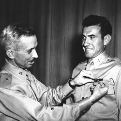 "Brig. Gen. Isaiah Davics, commanding general at Army Flying School in Midland, Texas., pins a pair of silver bombardier wings on Lt .Lou Zamperini on Aug. 14, 1942. In 1936. The original caption for this photo read: ""Zamperini, an international track star, while in Berlin for the Olympic Games as Uncle Sam's ace miler, yanked down a Nazi swastika right in front of Hilter's Palace.""   The Associated Press"