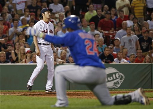 Red Sox relief pitcher Koji Uehara reacts after giving up an RBI sacrifice fly to the Cubs' Luis Valbuena, who kneels to watch teammate Anthony Rizzo score in the ninth inning at Fenway Park on Tuesday. The Associated Press