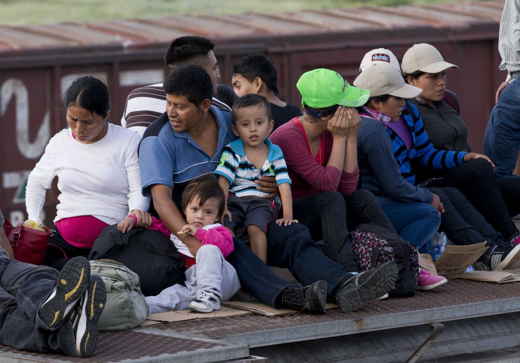 Central American migrants ride a freight train during their journey toward the U.S.-Mexico border in Ixtepec, Mexico, this month. Maine Gov. Paul LePage says he has learned that eight cross-border children have been placed in Maine.