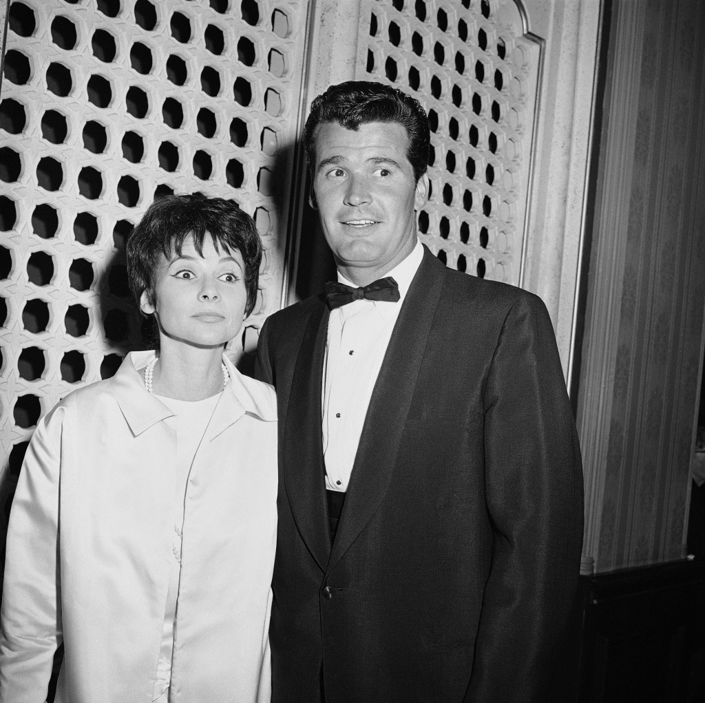 "Jim Garner of the TV program ""Maverick?""arrives with his wife, Lois Clarke, at the Emmy Awards, in this April 15, 1958  photo. The Associated Press"
