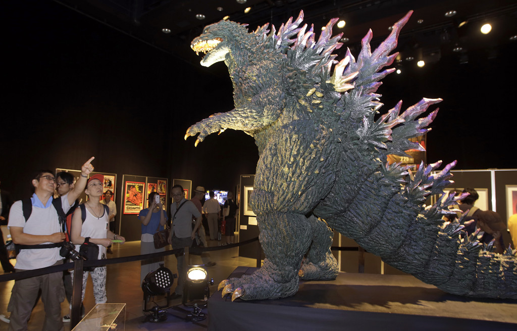 Japanese Godzilla devotees Yoshihiko Horie and his wife Shizue look at the scale model of Godzilla at Godzilla Expo in Tokyo on Friday.