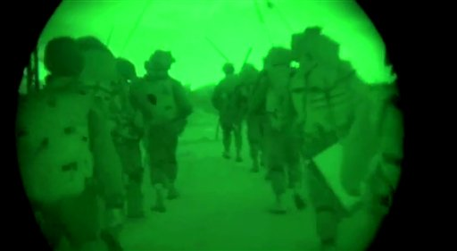 This image made from video shot through a night vision scope shows troops on the move during the early hours of a ground offensive in the Gaza Strip. The Associated Press / Israeli Defense Forces