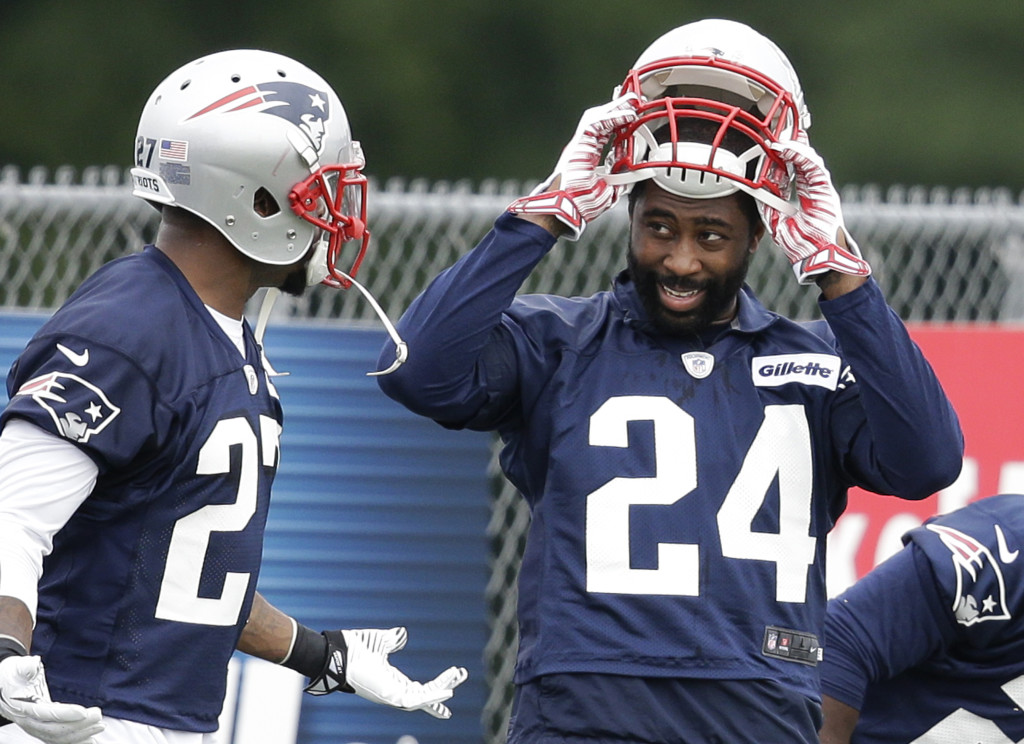 Patriots cornerback Darrelle Revis, right, speaks with strong safety Tavon Wilson during a training camp practice at Gillette Stadium on Thursday. The Associated Press