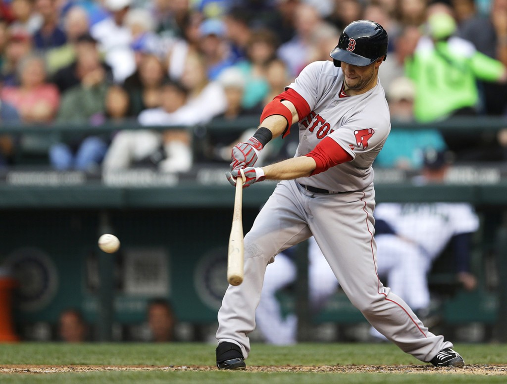 Daniel Nava hits an RBI single against the Seattle Mariners. The Associated Press