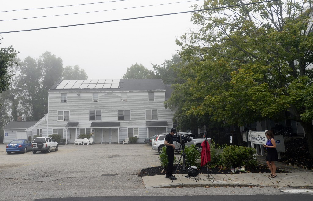 A TV crew works at the scene at RiverView Apartments in Saco Monday where a family of five were found dead on Sunday. Shawn Patrick Ouellette / Staff Photographer