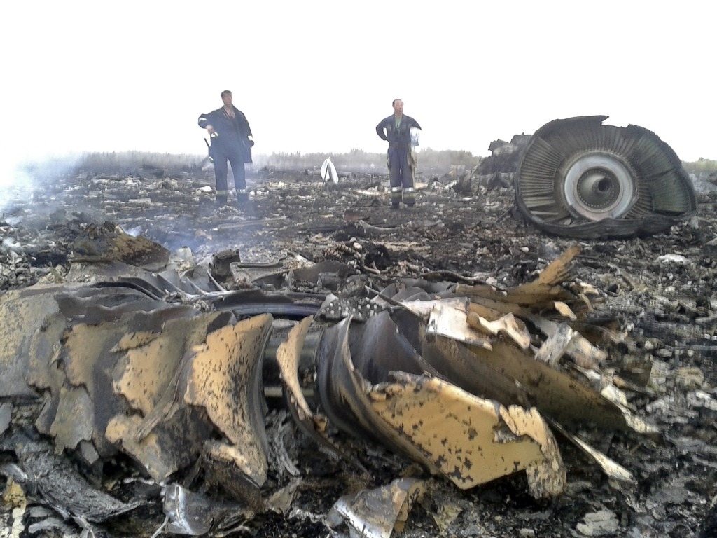 Emergencies Ministry members work at a site of a Malaysia Airlines Boeing 777 plane crash near the settlement of Grabovo in the Donetsk region of Ukraine on Thursday.