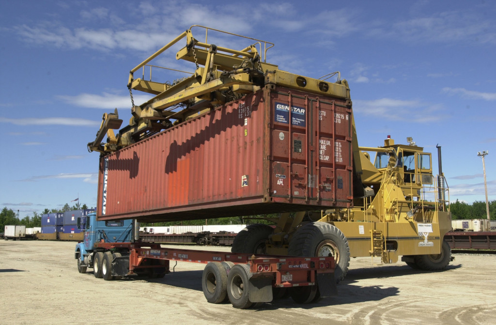 A shipping container at the Maine Intermodal Terminal in Auburn is uncoupled and lifted from a tractor-trailer to be placed on a railroad car in this 2002 photo. At its peak in 1998, about 12,000 containers moved through the terminal, says Chalmers Hardenbergh, publisher of an industry newsletter, but by 2009 the terminal moved only 800 containers. Press Herald file