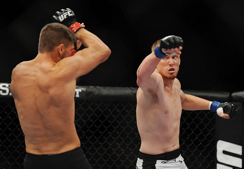 Tom Watson, red gloves and Sam Alvey, blue gloves, square off in a middleweight bout at the Cross Insurance Center in Bangor on Saturday for Ultimate Fighting Championship fight night. Kevin Bennett/Special to the Telegram