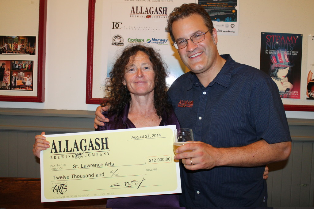 Deirdre Nice, executive and artistic director of St. Lawrence Arts, stands with Rob Tod, founder of Allagash Brewing Company, which donated  $!2,000 to the Portland arts center.