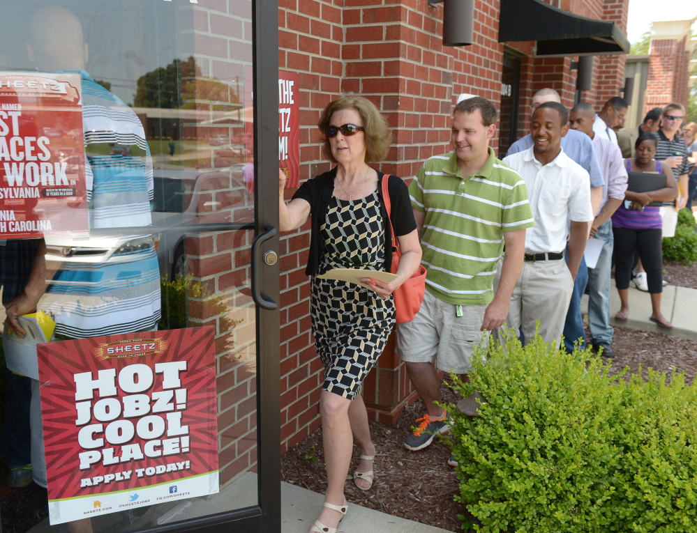 """Crowded job fairs are a common sight these days, like this one in Burlington, N.C. """"We don't have an economy that is as robust as we need it to be,"""" said Christine Owens, executive director of the National Employment Law Project."""