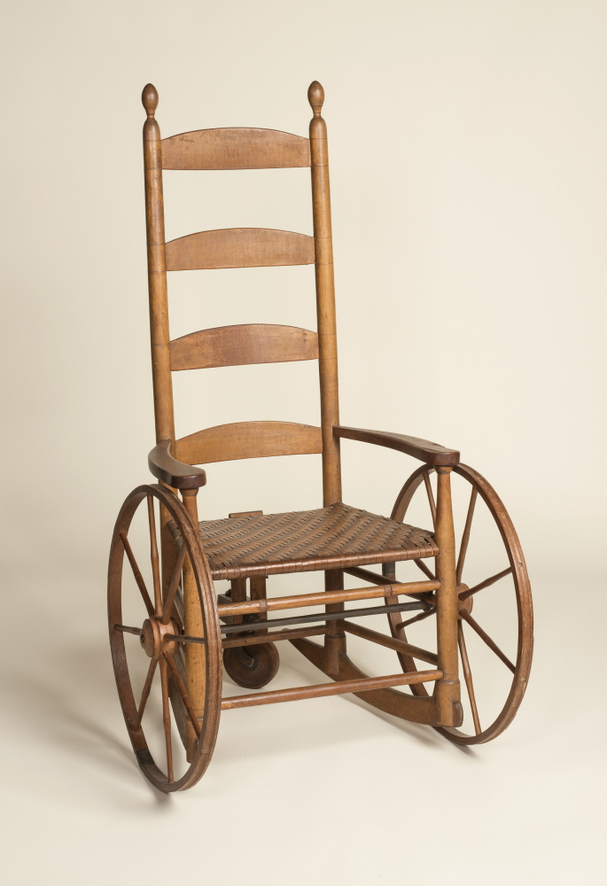Photo credit: Alan LaValle.   Rocking Armchair Adapted to a Wheelchair, 1810-1830, Maker Unknown. Collection of the Shaker Museum| Mount Lebanon, New Lebanon, New York.