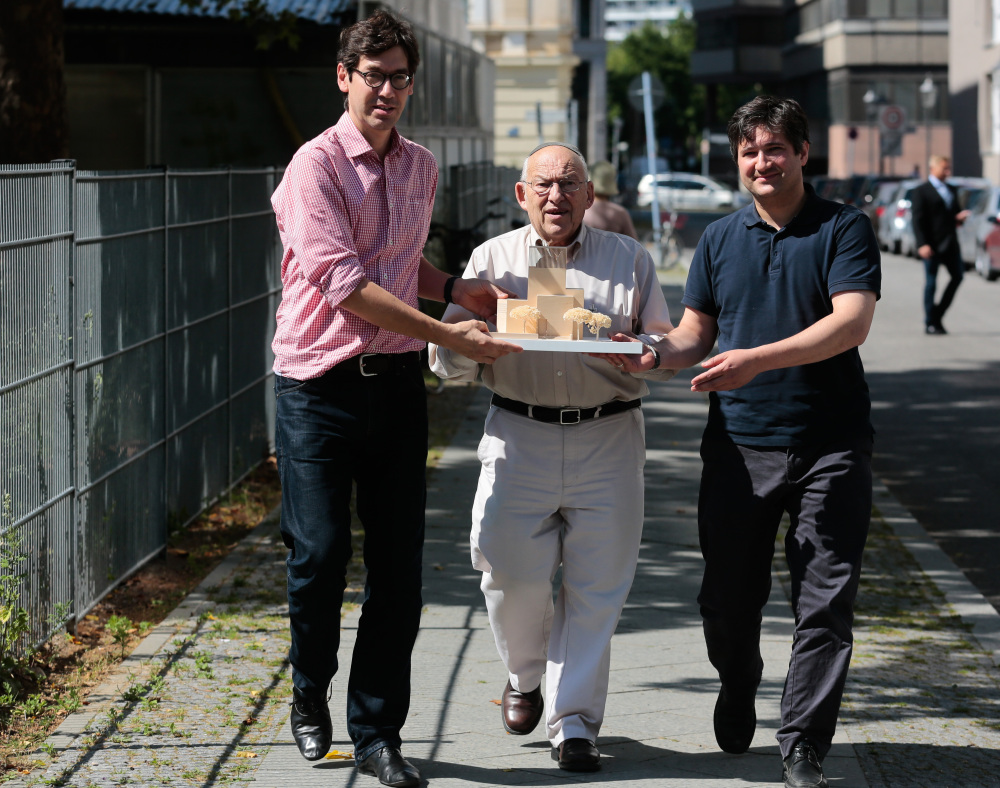 "Protestant Pastor Gregor Hohberg, left, Rabbi Tovia Ben Chorin, center, and Imam Kadir Sanci show a model of the planned prayer and education building, the ""House of One,"" in Berlin. The building will house a synagogue, a Christian church and a mosque."