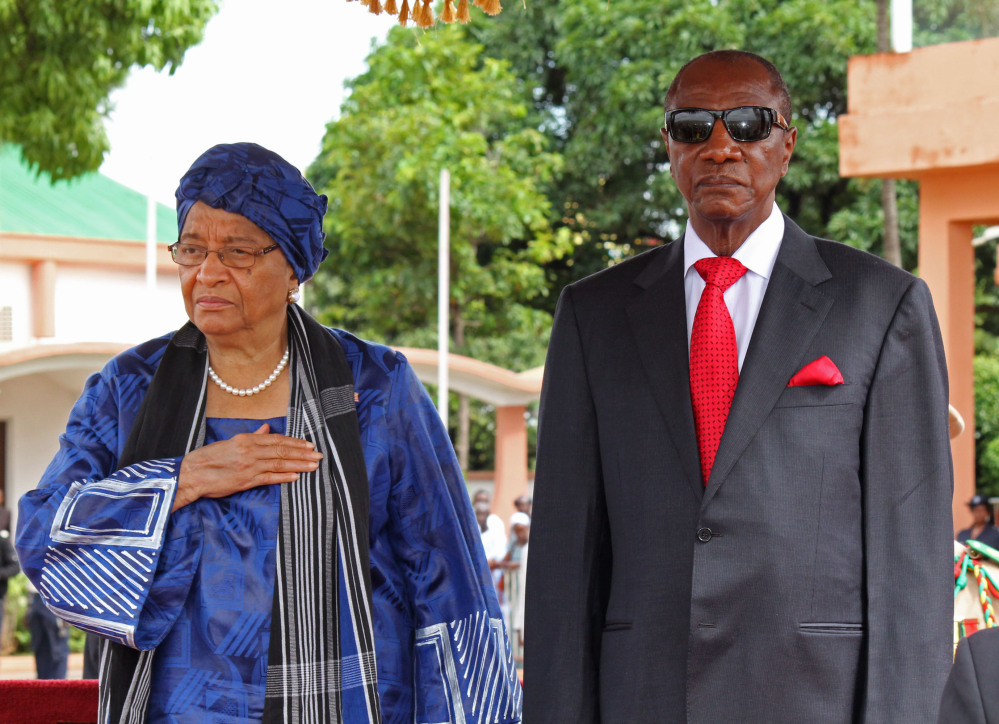 Liberia President Ellen Johnson Sirleaf, left, and Guinea President Alpha Conde, right, pose after meetings about the Ebola virus in Conakry, Guinea, on Friday. An Ebola outbreak has killed more than 700 people in West Africa and sickened more.