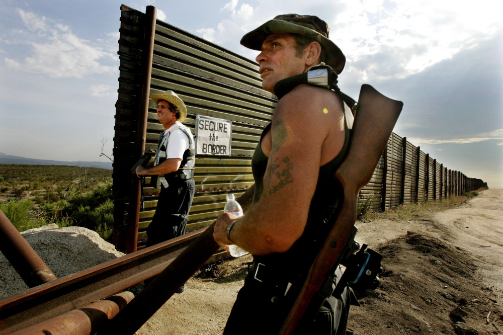 In this 2005 photo, California Minutemen scan the border for immigrants trying to cross illegally. The new Operation Secure Our Border: Laredo Sector includes patrolling private land on the border with the permission of ranch owners.