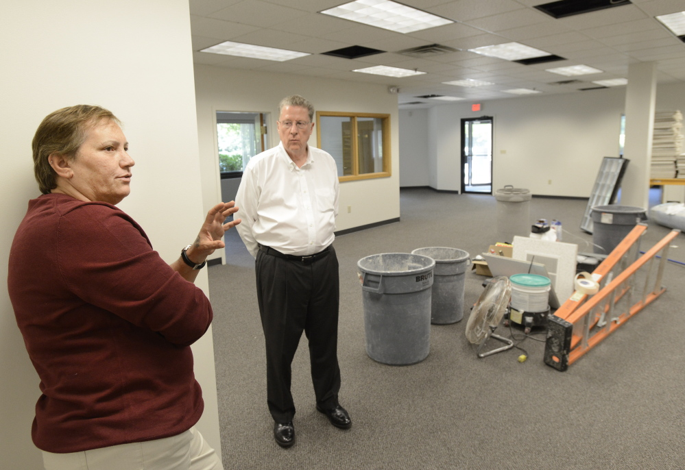 SOUTH PORTLAND, ME - AUGUST 1: Myra Orifice and Robert Harrison of LogistiCare show their new office space at 400 Southborough Drive in South Portland.  (Photo by John Patriquin/Staff Photographer)