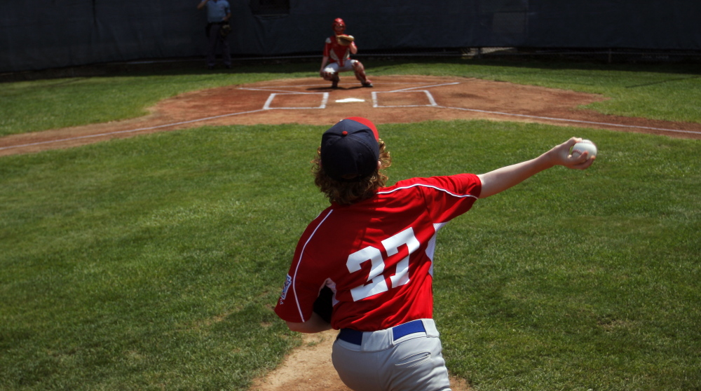 A young player fires a pitch during the opening day of the Little League Baseball state tournament, and you can be sure there were plenty of people keeping track of how many pitches he throws. That's the new law in Little League, aiming to protect young arms.