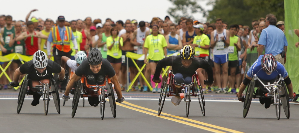Wheelchair participants pull away from the starting line during the 17th annual TD Beach to Beacon 10K in Cape Elizabeth on Saturday.