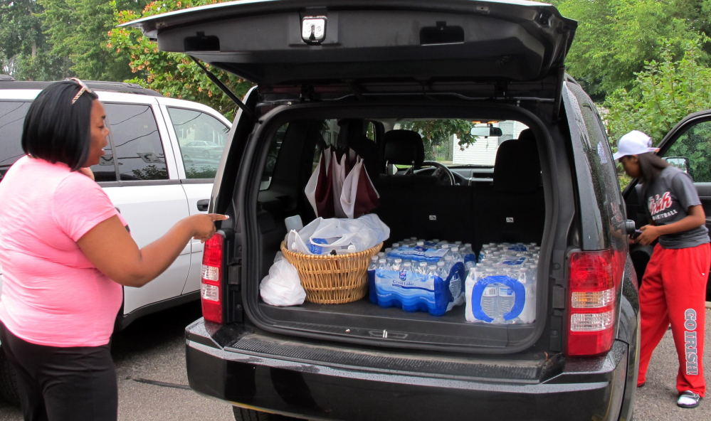 Aundrea Simmons's minivan is laoded with with cases of bottled water she bought after Toledo warned about 400,000 residents not to use its water on Saturday.