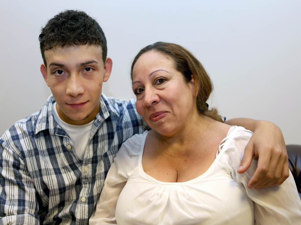 Celvyn Mejia Romero sits with his mother, Susana Romero, before an interview at Greater Boston Legal Services. His tenacious – and unusually long – bid for asylum offers a singular glimpse into the complex world of immigration law and rules.