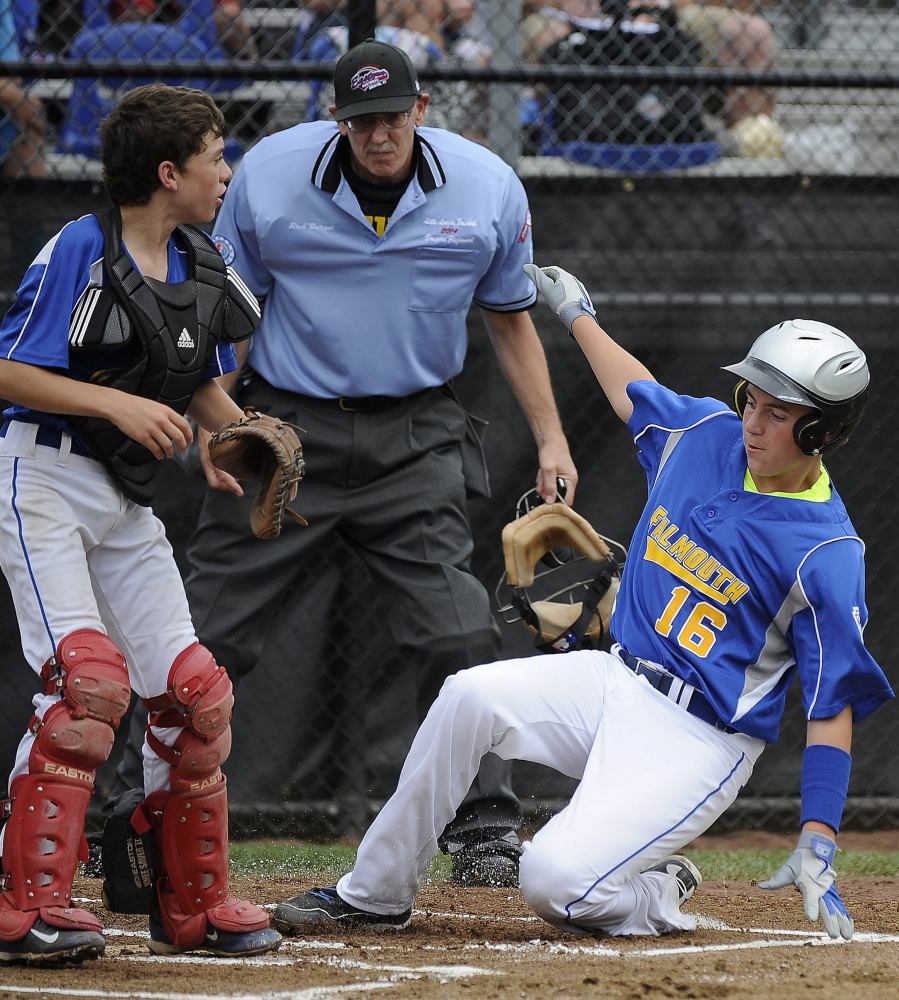 Falmouth's Sam Manganello scores as catcher Jonah Roberts  waits for the throw Sunday during a 10-4 win for Williston, Vermont at the Little League New England Regional.