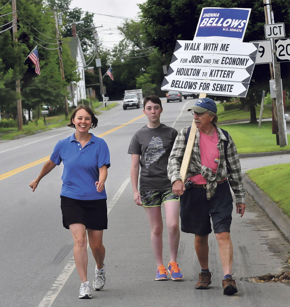 U.S. Senate candidate Shenna Bellows, left, walks along School Street in Unity last week as part of a 350-mile trip that should reach Kittery by Aug. 12. David Leaming/Morning Sentinel