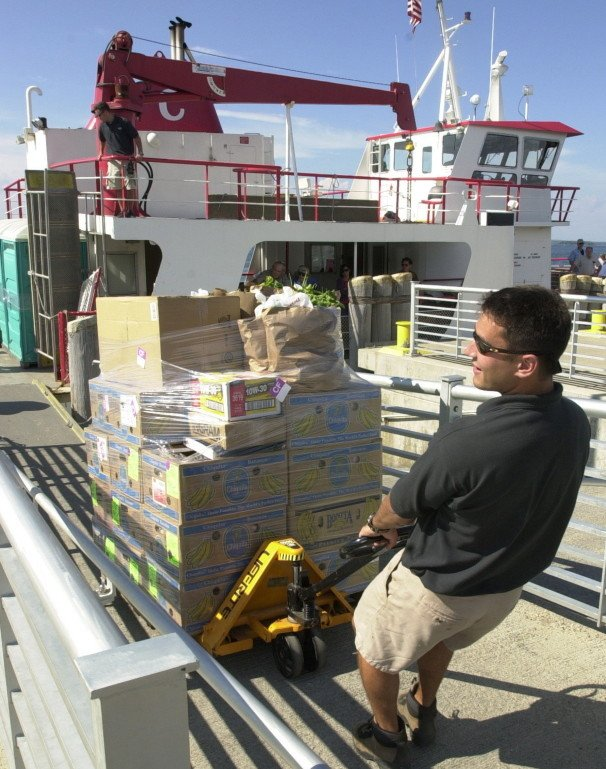 Groceries are unloaded from a Casco Bay Lines ferry onto Long Island. Unrefrigerated food shipments and other cargo are usually the last to come off the island ferries.