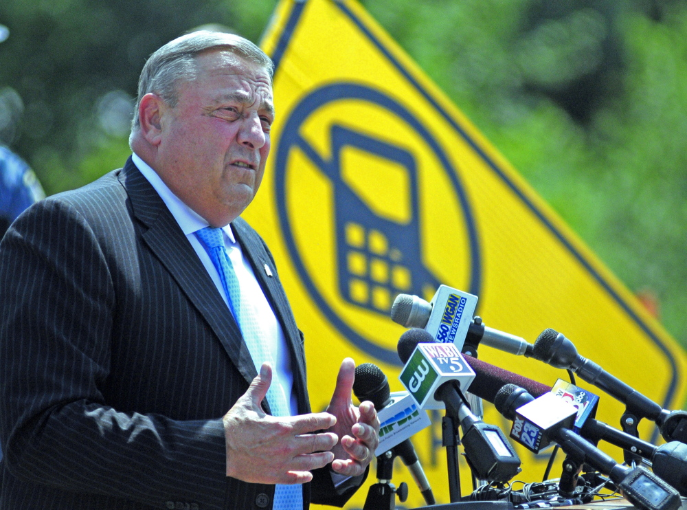 Gov. Paul LePage addresses distracted driving on Tuesday during a news conference in the parking lot outside State Police headquarters in Augusta.