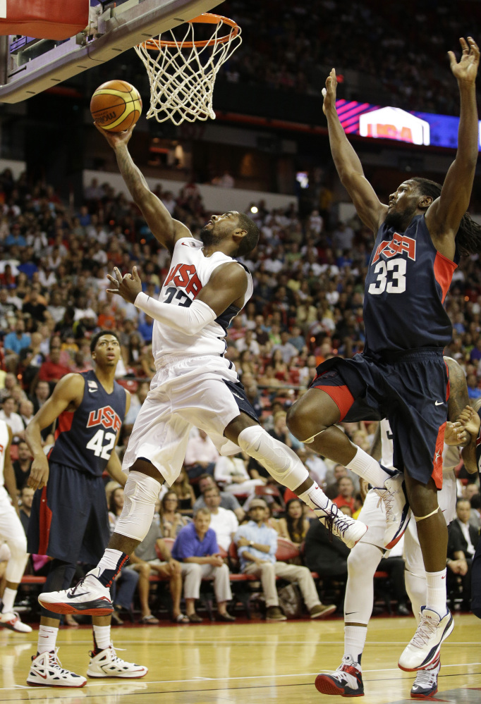 Cleveland Cavaliers' Kyrie Irving, left, goes up for a shot against Denver Nuggets' Kenneth Faried during the USA Basketball Showcase game Friday.