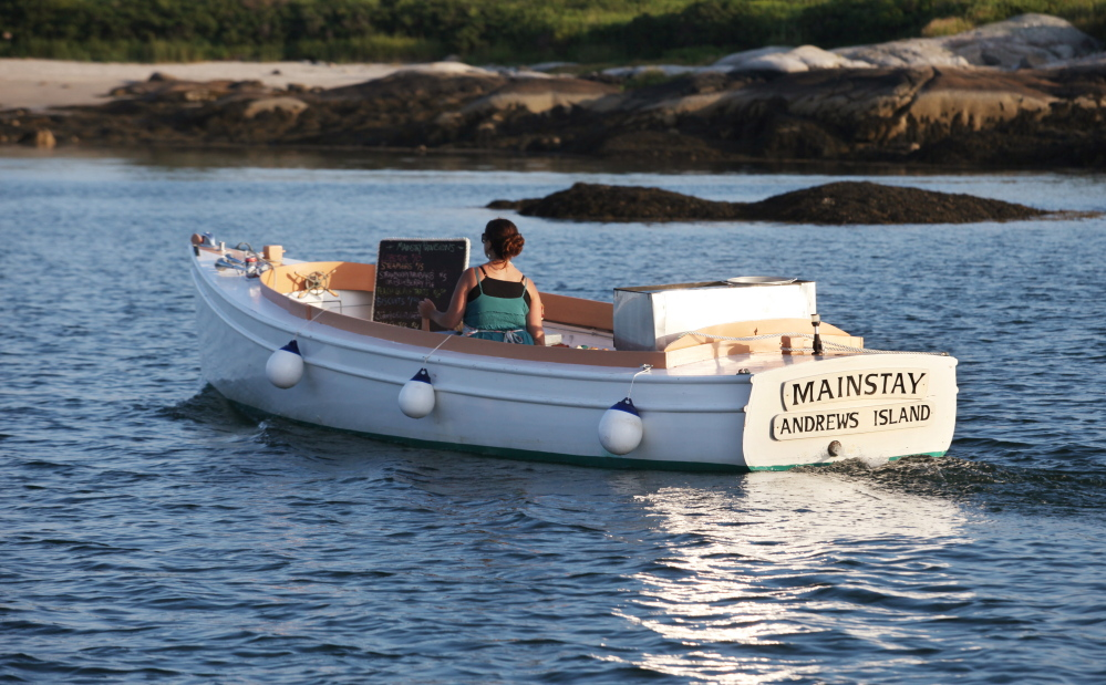 Reilly Harvey runs her boat Mainstay around the harbor between Dix Island and High Island for her business, Mainstay Provisions. Harvey sells lobster dinners and baked good to boaters from the 1960s North Haven launch.