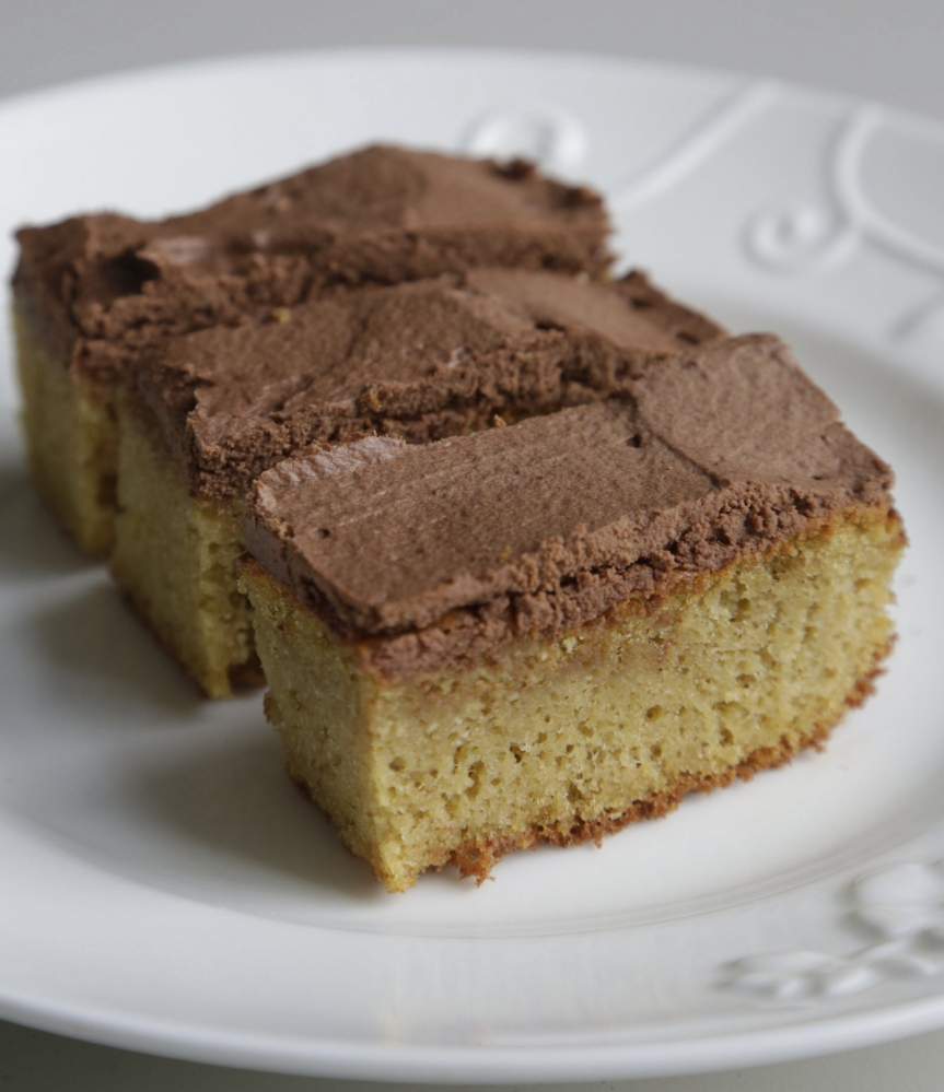Lisa Howard developed gluten-free recipes like almond sponge cake with chocolate ganache frosting, left, and collard-wrapped tuna and hummus rolls, right, using a whole foods approach first for the culinary challenge and then for her own health reasons after she discovered her wheat allergy.