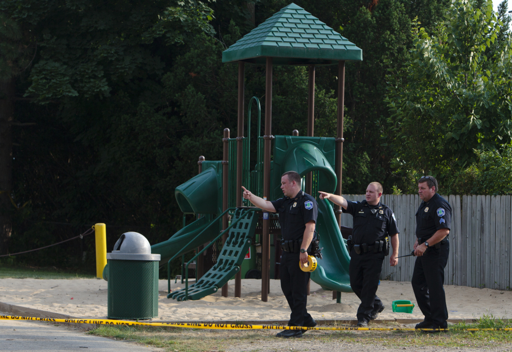 Kentwood police investigate a stabbing that occurred at a playground in Pinebrook Village mobile home park in Kentwood, Mich., on Monday.