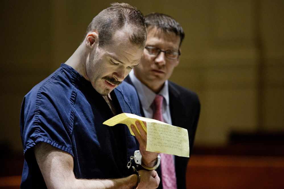 Brian Morin reads a hand-written letter asking Justice MaryGay Kennedy to sentence him to a psychiatric facility so he can receive the help and medications he needs. Kennedy sympathized but said the state does not have such an option for defendants deemed competent to stand trial.  Gabe Souza/Staff Photographer