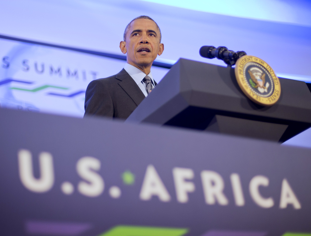 President Obama listens to a question during his news conference Wednesday at the US African Leaders Summit in Washington. Obama and dozens of African leaders opened talks on two issues that threaten to disrupt economic progress on the continent: security and government corruption.