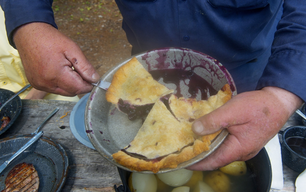 To top off a great shore lunch, guide Lance Wheaton serves big slices of homemade blueberry pie baked by his wife, Georgie.