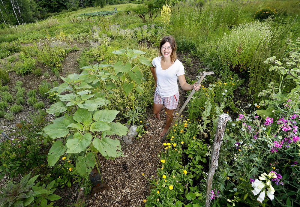 Cassandra Sears in the herb garden at Winslow Farm in West Falmouth.