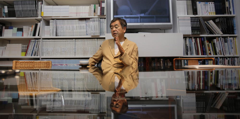 Japan's Kengo Kuma discusses architecture at his office in Tokyo. A new generation of japanese architects believes the world has fallen out of love with steel and concrete skyscrapers, so they are designing human-friendly alternatives that some say have roots in the elegant simplicity of the traditional Japanese tea house.
