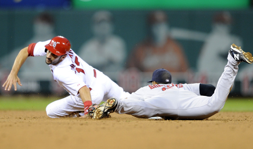 Matt Carpenter, left, of St. Louis is tagged out stealing by Boston's Xander Bogaerts on Thursday night.