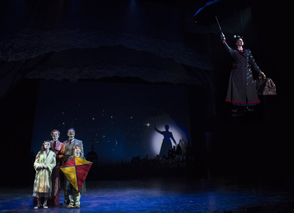 The Banks family watches Mary Poppins drift away after her work is done in the Ogunquit Playhouse's production of the Disney classic.