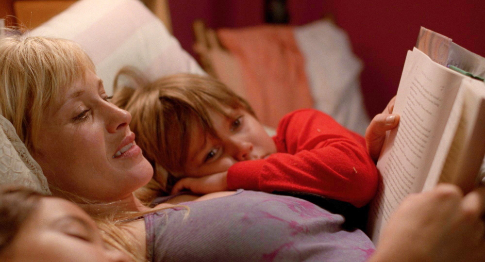 "Patricia Arquette, as Mom, reads to her children, played by Ellar Coltrane and Lorelei Linklater, in ""Boyhood."" ""I always knew I was working on something beautiful"" she says about working on the film over the course of 12 years."