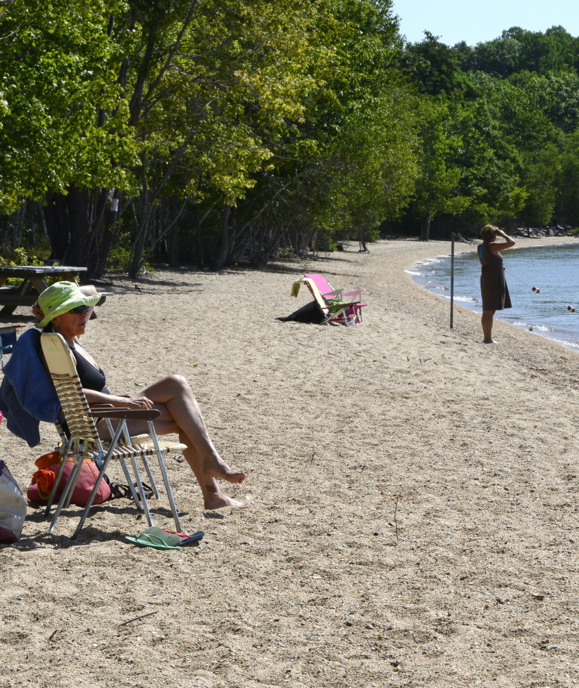 Vermonter Deborah Roberts can watch her family safely enjoy the gentle shallow Long Beach. Each of Frye Island's 13 beaches seems to be somebody's favorite place to spend a summer day.