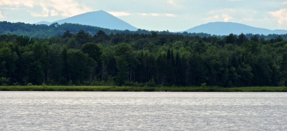 Sugarloaf Mountain's classical pyramidal peak is especially impressive when viewed from a canoe on Wesserunsett Lake in picturesque Somerset County.